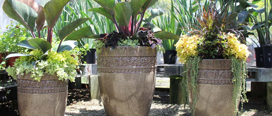 brown planters in garden center