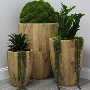 Pots Made from Wood and Grass